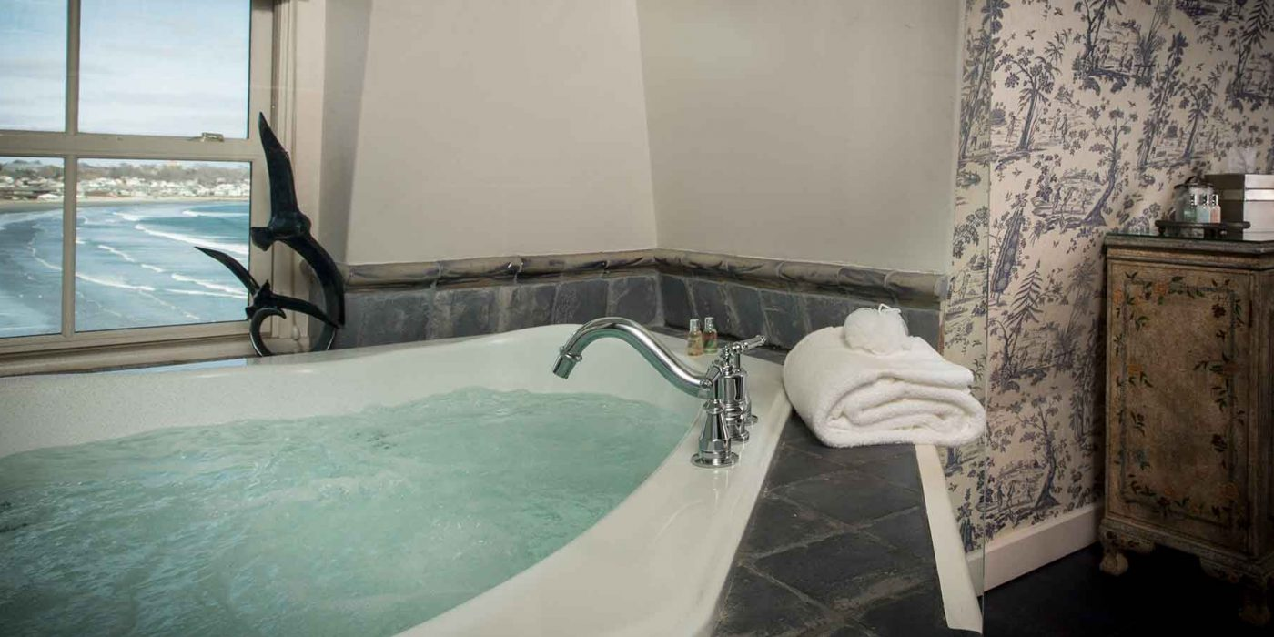 The French Provincial Guest Room features a large Jacuzzi tub overlooking the Atlantic Ocean and Easton's Beach.