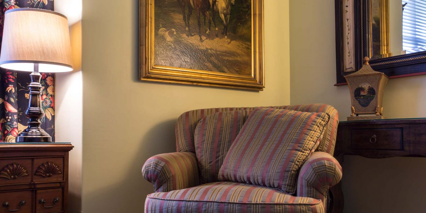 Take a seat inside our Colonial Guest Room with characteristic décor of a traditional colonial home