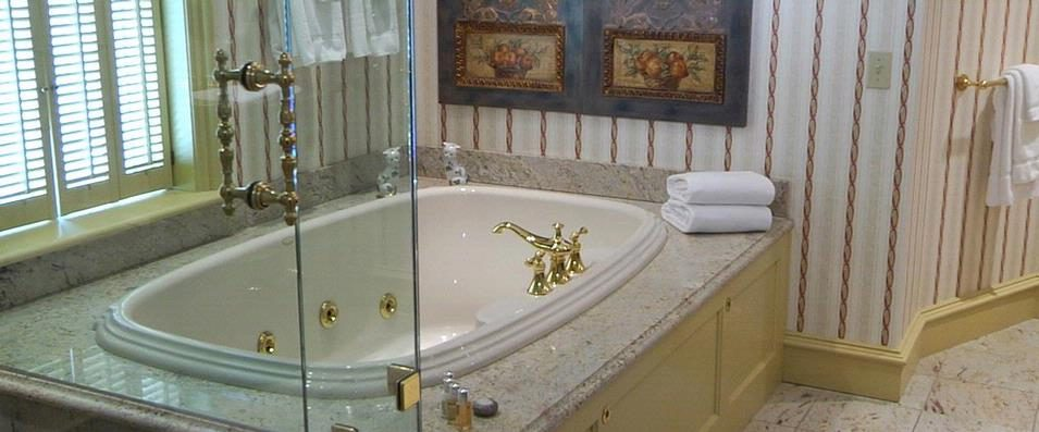 The Federal Guest Room bathroom has an oversized marble bath with a walk-in shower and separate double Jacuzzi tub