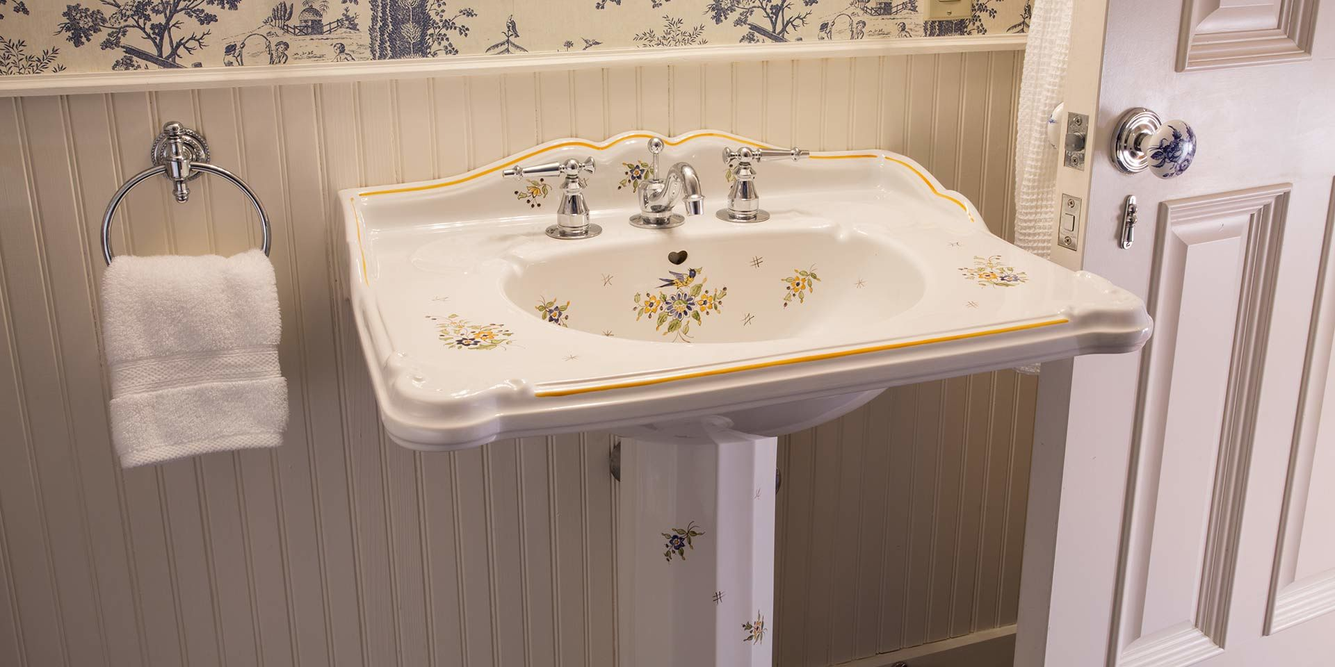 The sink inside the bathroom of the French Provincial Guest Room