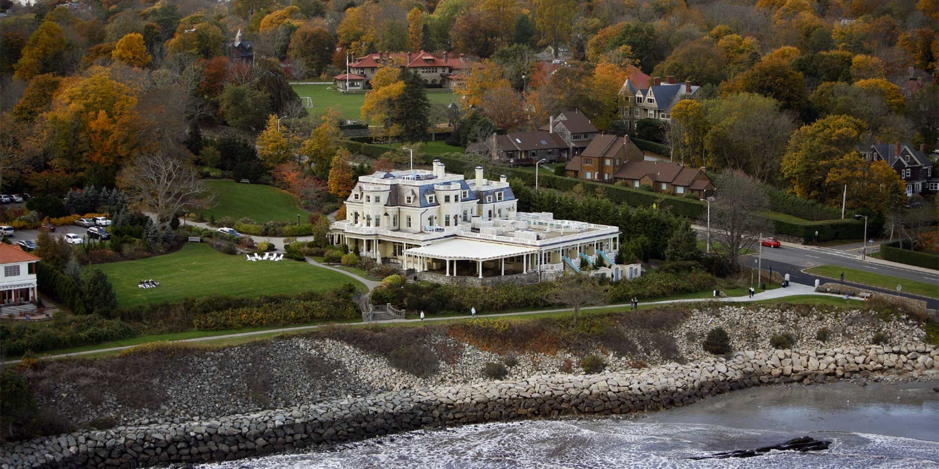 Aerial view of The Chanler at Cliff Walk with Fall Foliage and the Newport Pell Bridge in the background