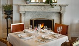 Dine aside the Cara Fireplace for your Winter Respite package at The Chanler
